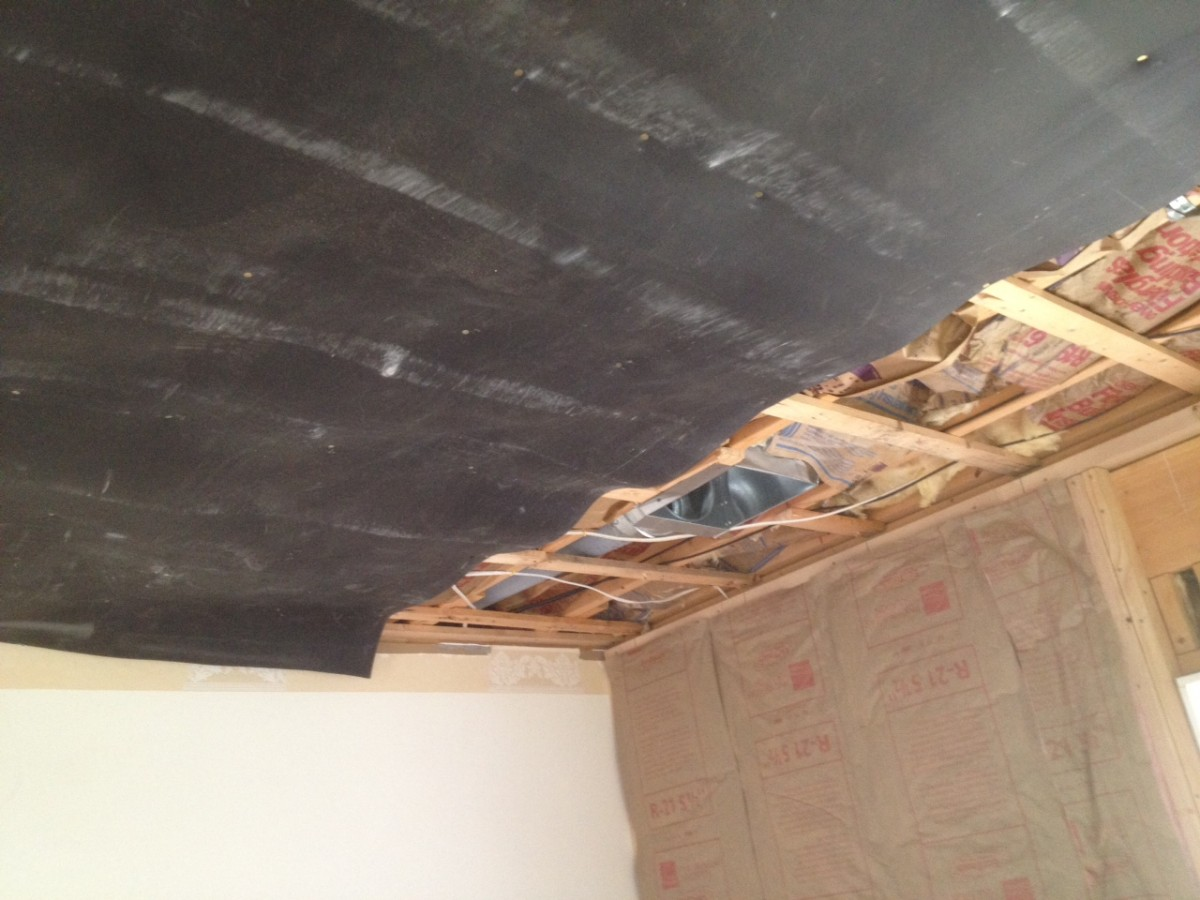 Sound Barrier secured to the ceiling - Residential Home Soundproofing, Living Room Ceiling Soundproofing